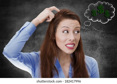 Closeup portrait young business woman scratching head, thinking deeply how to make money looking sideways isolated black background bubble filled with dollar signs. Facial expression, emotion, feeling