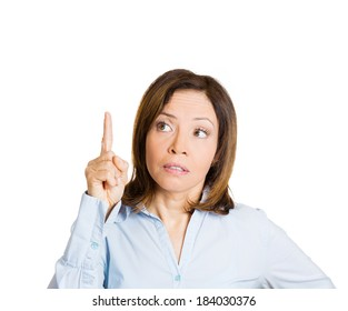 Closeup portrait, young business woman  pointing up, looking at something above showing with index finger, isolated white background. Positive human emotion, facial expression, feeling, symbols, signs
