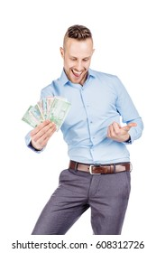 closeup portrait of young businessman holding and counts money dollar bills in hands, isolated on white background. emotion facial expression feeling. financial reward savings