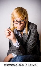 closeup portrait of young businesswoman with pencil