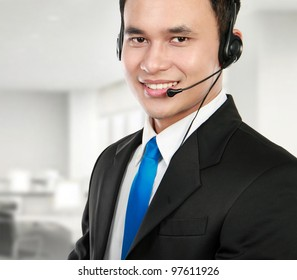 Closeup portrait of young call center speaking over headset