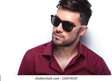 closeup portrait of a young casual man looking away from the camera. on white background