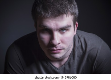 Closeup portrait of a young caucasian male, studio shot