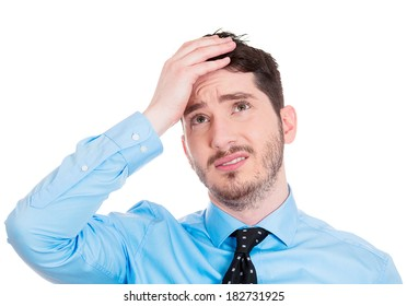 Closeup portrait young confused sad business man, troubled, deep thought, isolated white background. Negative human emotions, facial expressions, life perception, reaction, attitude