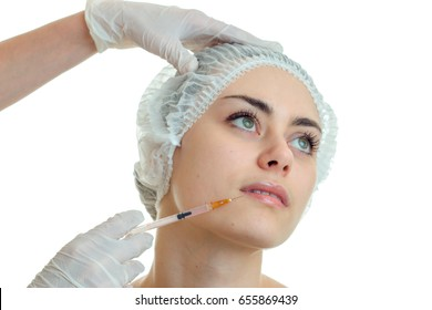 close-up portrait of a young cute girls hair in the CAP which holds facial procedures esthetician