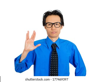 Closeup portrait of young, dorky, geek squad, trekkie man showing vulcan sign to live long and prosper, isolated on white background. Positive emotion facial expression feeling, symbols, attitude