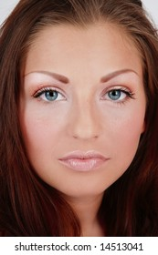 Close-up portrait of young fresh girl with clear makeup