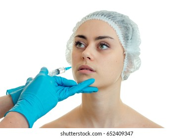 close-up portrait of a young girl in the medical CAP which the doctor makes an analgesic injection to face
