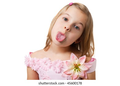closeup portrait of a young girl puting out her tongue