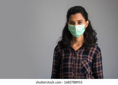 Closeup portrait of a young girl or woman wearing a medical or surgical mask