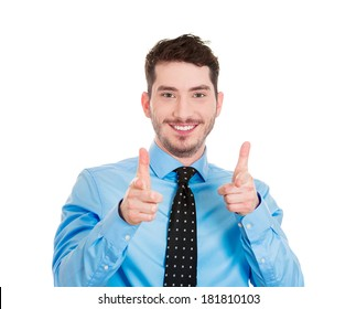 Closeup portrait of young handsome man with two hands guns sign gesture pointing at you camera, isolated on white background. Positive human emotion facial expression feelings, signs and symbols