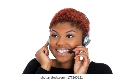 Closeup portrait of young happy successful woman customer service representative or call centre worker or operator or support staff speaking with head set, isolated on white background.