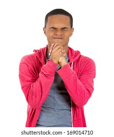 Closeup portrait of young man with closed eyes praying hands clasped hoping for best asking for forgiveness or miracle isolated on white background. Positive human emotion facial expression feelings