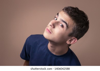Closeup portrait of young man eavesdropping. Human facial expression, emotion, feeling, sign symbol body language