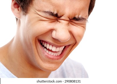Close-up portrait of young man laughing out loud