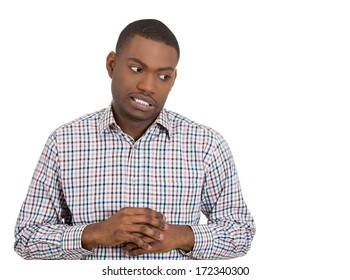 Closeup portrait of  young man playing nervously with his hands because he made mistake and feels guilty of his actions, isolated on white background. Negative emotion facial expression feeling