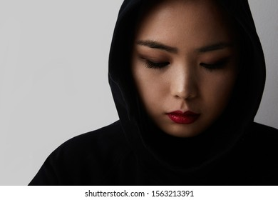 Close-up portrait of young muslim asian woman posing on the white background. Isolated.
