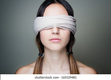 Close-up portrait of young Naked blindfold woman