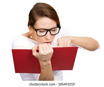 Closeup portrait young, nerdy woman with big black eye glasses trying to read book but having difficulties seeing text because of vision problems, clipping path. Negative emotion facial expression