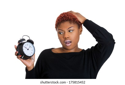 Closeup portrait of young pretty beautiful woman frustrated by lack of time to perform all duties for the day, isolated on white background. Negative emotion facial expression feelings, body language