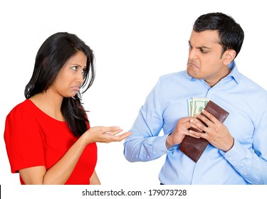 Closeup portrait of young pretty woman begging for money, but upset man is reluctant to give cash dollar bills out, isolated on white background. Negative emotion facial expression feelings.
