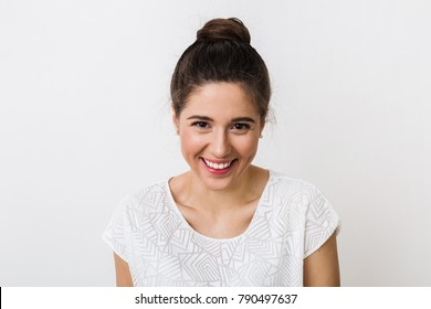 close-up portrait young pretty woman smiling in white t-shirt on white background, happy, positive mood, isolated, sincere smile