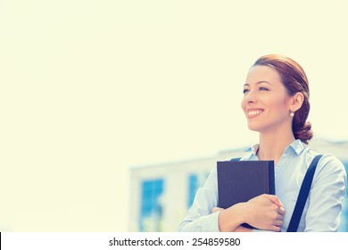 Closeup portrait, young professional, beautiful confident businesswoman in blue shirt smiling isolated outdoor city background. Positive human emotions, facial expressions, life perception