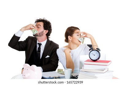 Closeup portrait of young rich couple, handsome man, beautiful woman wiping there noses with cash, dollar bills, isolated on white background. Upper class wealth, excess concept. Emotions, expressions