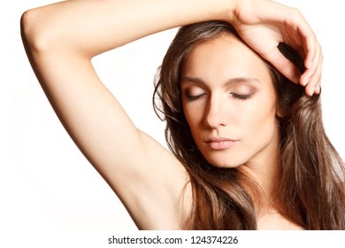 Close-up portrait of young sensual woman with her hand near head.Picture is ideal for face&skin care products commercial