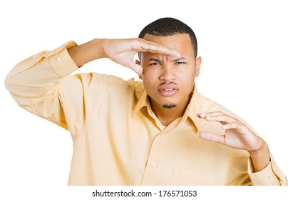 Closeup portrait of a young serious curious squinting man hand on head, peering ahead, searching for something, looking to the future at the camera, isolated on a white background. Sign, symbols