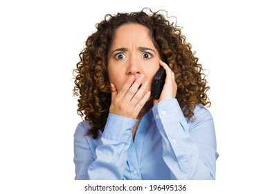 Closeup portrait young shocked business woman, corporate employee talking on cell phone having unpleasant, bad conversation, isolated white background. Negative emotions, facial expressions, reaction