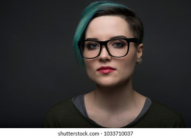 closeup portrait of young short haired student woman. lgbt activist