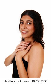 A closeup portrait of a young smiling woman in a black dress, isolated on white background.