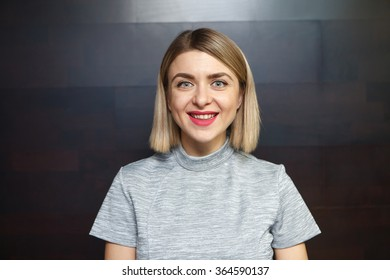 Close-up portrait of young smiling woman casual portrait in positive view