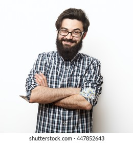 Closeup portrait of young succesful bearded hipster man with shirt and glasses over a white background. Succes cocept with square composition