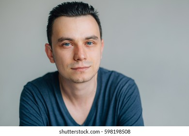 Close-up portrait of young thoughtful handsome man. Attractive smart male