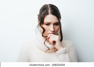 Closeup portrait of young unhappy woman, biting her nails looking at you with craving for something, anxious, worried. Negative emotions, facial expression, feelings