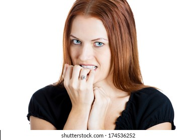 Closeup portrait of a young unsure hesitant nervous woman biting her fingernails craving for something or anxious, isolated on white background. Negative human emotions facial expressions feelings