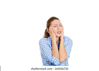 Closeup portrait of young upset professional beautiful woman, sad student, stressed wife, tired, having bad day news, headache, isolated on white background. Negative human emotion, facial expressions