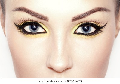 Close-up portrait of a young woman. Beautiful makeup. Cat-eyeliner.