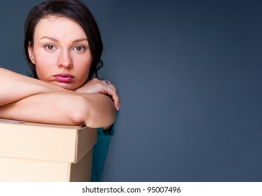 Closeup portrait of a young woman with boxes