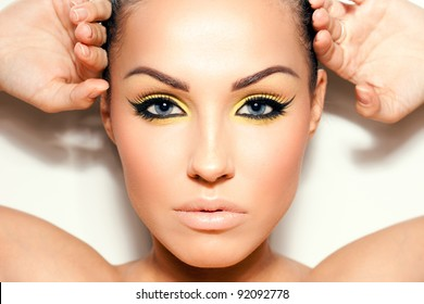 Close-up portrait of a young woman. Cat eyeliner makeup.
