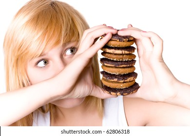 closeup portrait of young woman with chocolate chip cookies