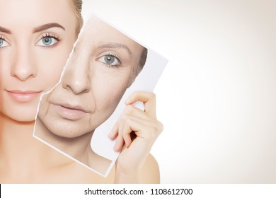 closeup portrait of young woman face holding portrait with old wrinkled face