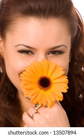 close-up portrait of young woman with flower on a white background