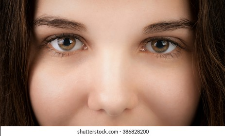 closeup portrait of young woman with hazel eyes, focus on eyes
