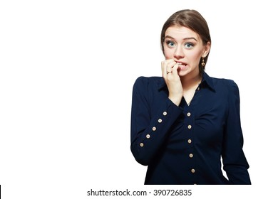 Close-up portrait of a young woman scared ,afraid and anxious biting her finger nails, looking to the camera, with wide opened eyes isolated on a white background. Human emotions