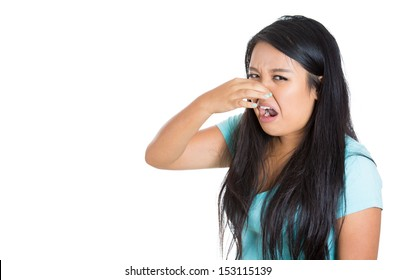 Closeup portrait of a young woman who covers her nose, looks away, something stinks, very bad smell, situation, isolated on white background