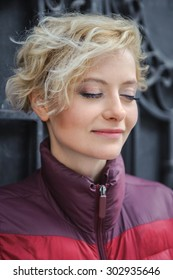 close-up portraits of beautiful girl closed her eyes in jacket