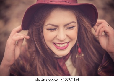 Closeup portraits of a beautiful girl in a pink hat in a retro style with a professional makeup and bright lipstick, emotions, smile, vintage